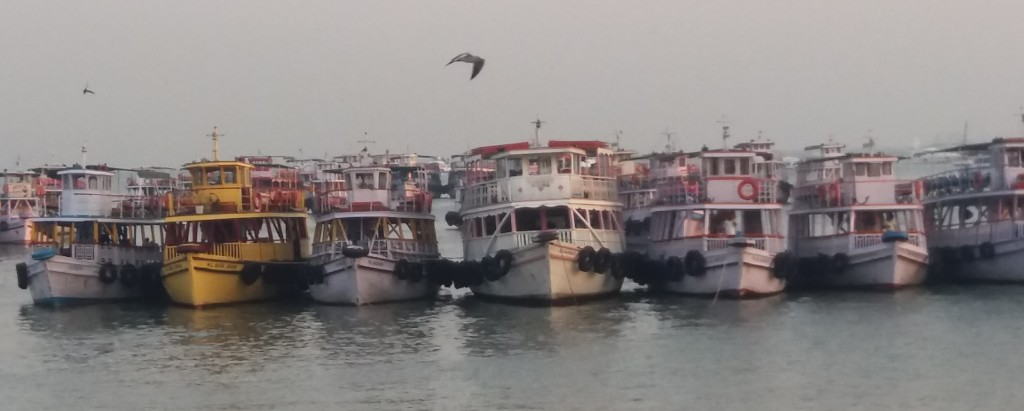boats waiting for tourists at the gateway of india